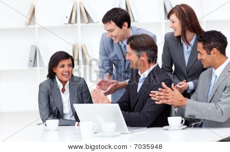 Laughing Businesswoman Applauded By Her Team