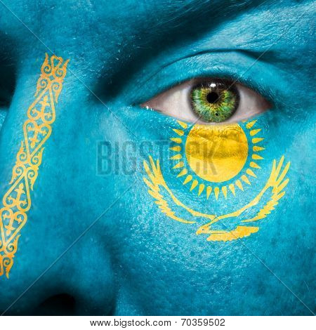 Flag Painted On Face With Green Eye To Show Kazakhstan Support
