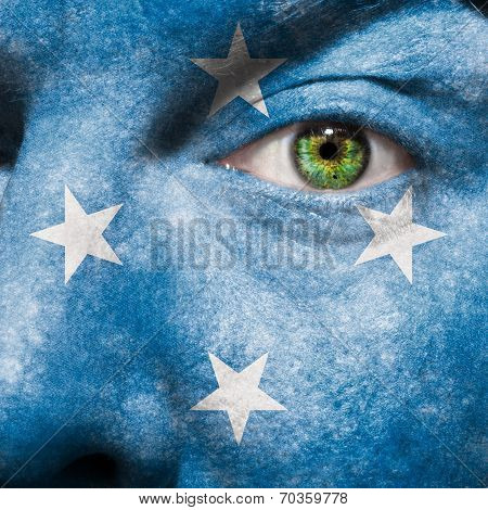 Flag Painted On Face With Green Eye To Show Micronesia Support