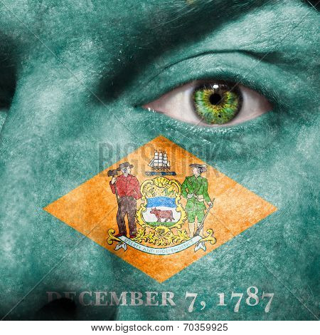 Flag Painted On Face With Green Eye To Show Delaware Support