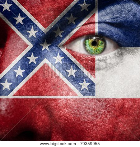 Flag Painted On Face With Green Eye To Show Mississippi Support