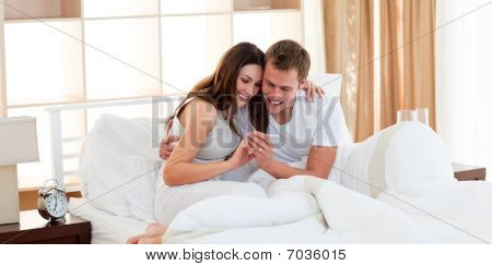 Merry Couple Finding Out Results Of A Pregnancy Test