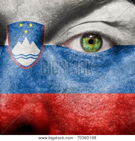 Slovenian Flag Painted On A Man's Face