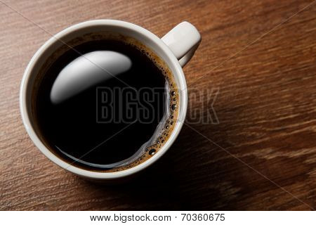 Cup Of Black Coffee On The Desk