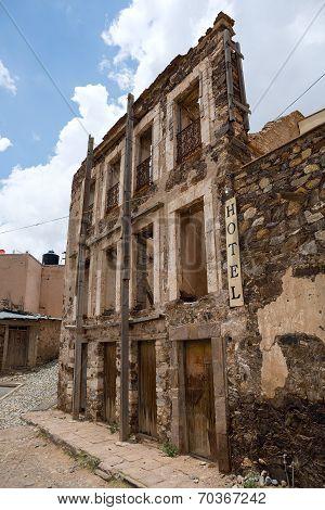 Abandoned Crumbling Hotel Facade