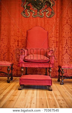 HAMPTON COURT, UK - AUGUST 03, 2014 - Red throne inside Hampton Court Palace near London, UK on August 03, 2014