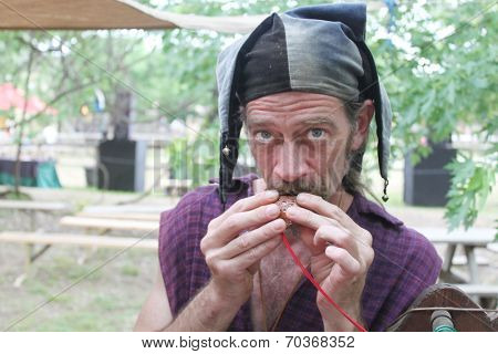 MUSKOGEE, OK - MAY 24: Whistle and flute maker shows off his newly crafted item at the Oklahoma 19th annual Renaissance Festival on May 24, 2014 at the Castle of Muskogee in Muskogee, OK