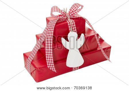 Stack Of Red Christmas Presents With White Angel Isolated On White Background