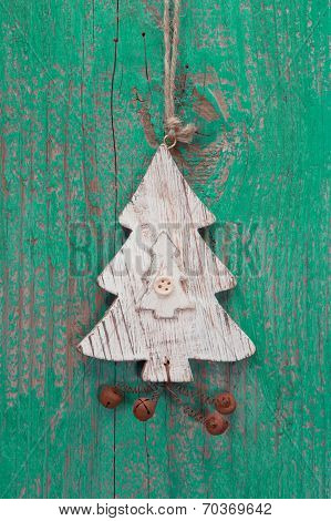 Handmade Christmas Decoration - Tree Carved On A Green Wooden Christmas Background