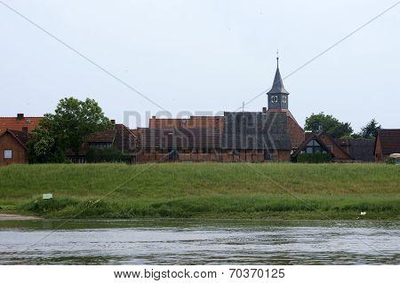 Village behind the dike