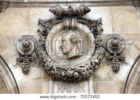 PARIS, FRANCE - NOVEMBER 08, 2012: Architectural details of Opera National de Paris: Haydn Facade sculpture. Grand Opera is famous neo-baroque building in Paris, France - UNESCO World Heritage Site.