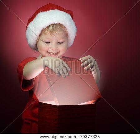 happy boy open christmas gift-box