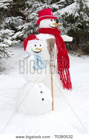 Winter - Two Snowmen In A Snowy Landscape With A Hat And A Red Scarf