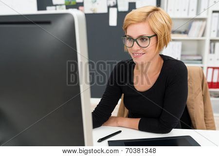 Attractive Woman In Glasses Working In The Office