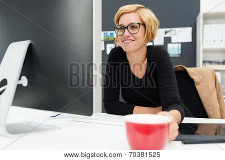 Businesswoman Drinking Coffee As She Works