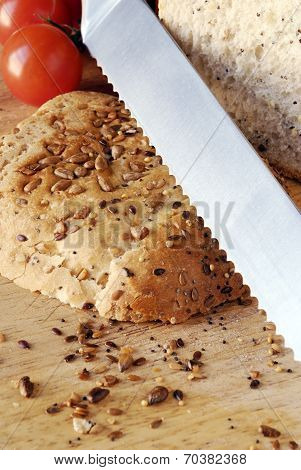 Seeded Bread On Wooden Board