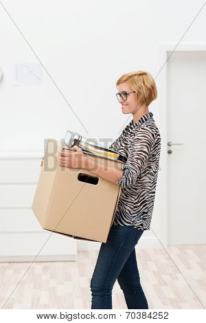 Woman Moving Office At Work