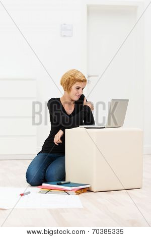 Young Woman Working On A Cardboard Box