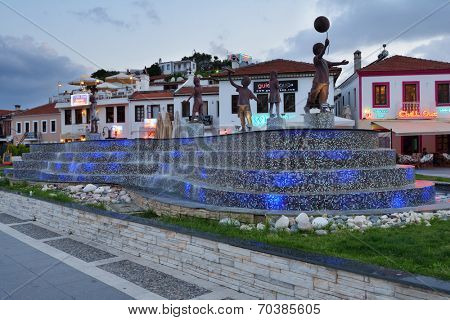 MARMARIS, TURKEY - MAY 15, 2014: Musical fountain on the embankment in evening. Marmaris population increases 10 times during the tourism season, and its nightlife rivals anything on the Turkish coast