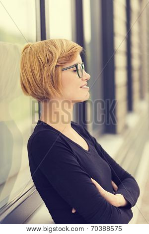 Young Businesswoman Standing Taking A Break