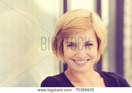 Retro Effect Portrait Of A Smiling Young Woman