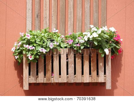 Brown Wooden Walls And Pink Flowers.