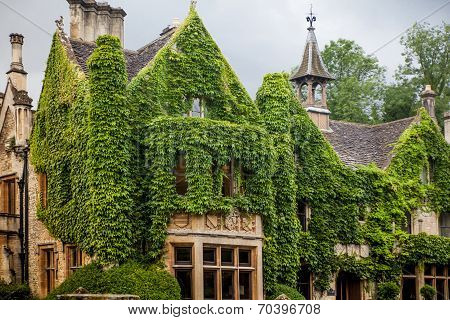 WILTSHIRE, CHIPPENHAM, UK - AUGUST 9, 2014: Castle Combe mansion and golf club