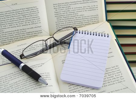 Accessories On Open Books