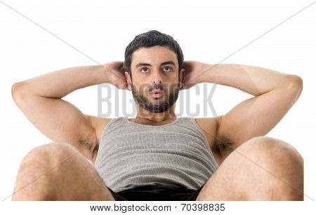 Attractive Latin Sport Man Wearing Running Clothes Doing  Sit Up Or Crunch