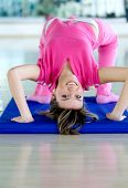 pic of bending over backwards  - girl at the gym bending backwards over a mat - JPG