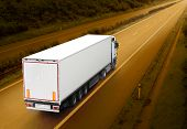 stock photo of fuel economy  - White truck on the highway - JPG