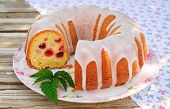 foto of pound cake  - Summer Lemon and Caraway Seed Bundt Cake with Raspberries Topped with Sugar Glaze selective focus on the cut - JPG