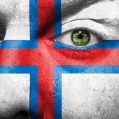 pic of faroe islands  - Flag painted on face with green eye to show Faroe island support - JPG