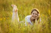 picture of beatitudes  - Happy cheerful girl lying in the grass - JPG