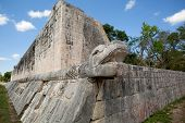 stock photo of snake-head  - Mayan snake head sculture on anient ball court - JPG