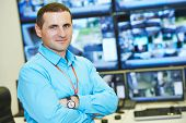 foto of supervision  - security executive chief in front of video monitoring surveillance security system - JPG
