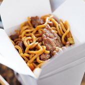 stock photo of lo mein  - beef lo mein in take out box - JPG