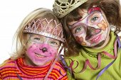 picture of little sister  - party little two sisters with painted happy face smiling - JPG