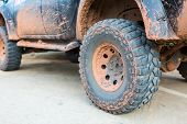 foto of four-wheel drive  - Muddy wheel - JPG
