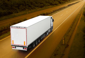 pic of fuel economy  - White truck on the highway - JPG