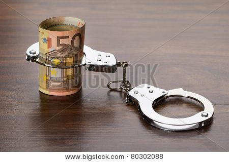 Euro Notes With Handcuffs