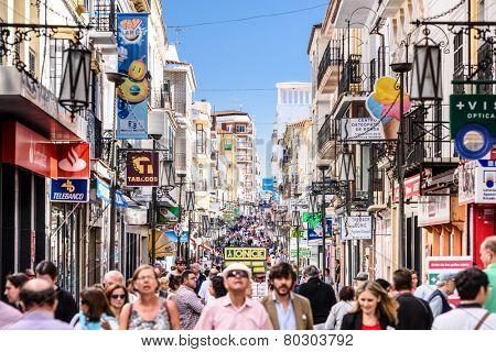 RONDA, SPAIN - OCTOBER 5, 2014: Crowds walk on Carretera Espinel pedestrian street in Ronda.