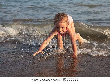 Little girl on sea beach.