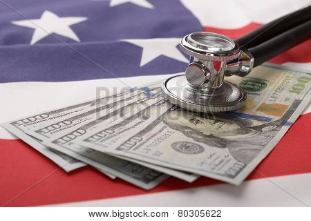 Stethoscope On Us Currency And American Flag