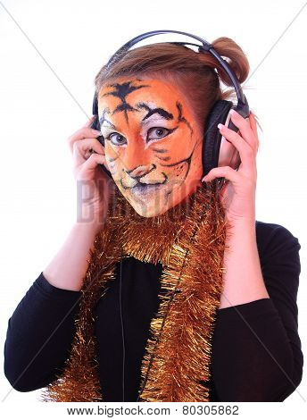 Girl a tiger in headsets listens music.