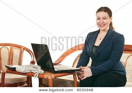 The Girl With The Laptop Sits At A Table And Calling By Phone. Isolated On White Background