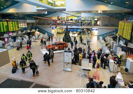 VILNIUS, LITHUANIA - DECEMBER 22: Passengers are registered on flights in the departure lounge on December 22, 2014 in Vilnius airport, Lithuania.