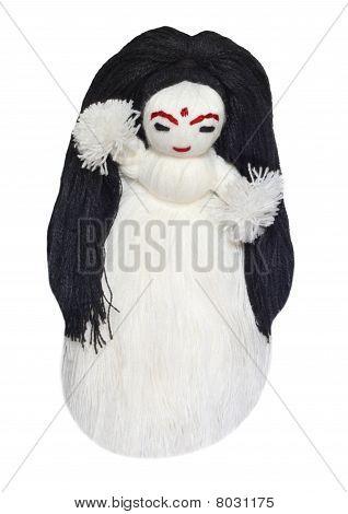 Close up of a woolen doll
