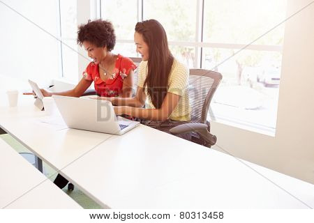 Two Women Working Together In Design Studio