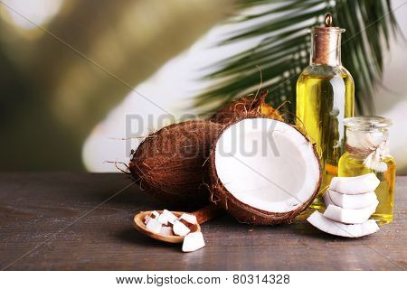 Coconuts and coconut oil on wooden table